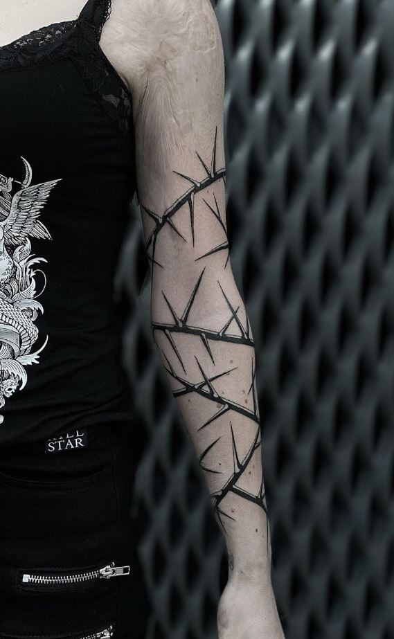 Black And Gray Thorn Tattoo