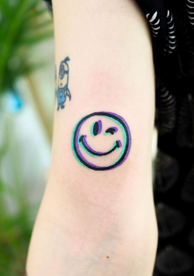 Winking Smiley Face Tattoo