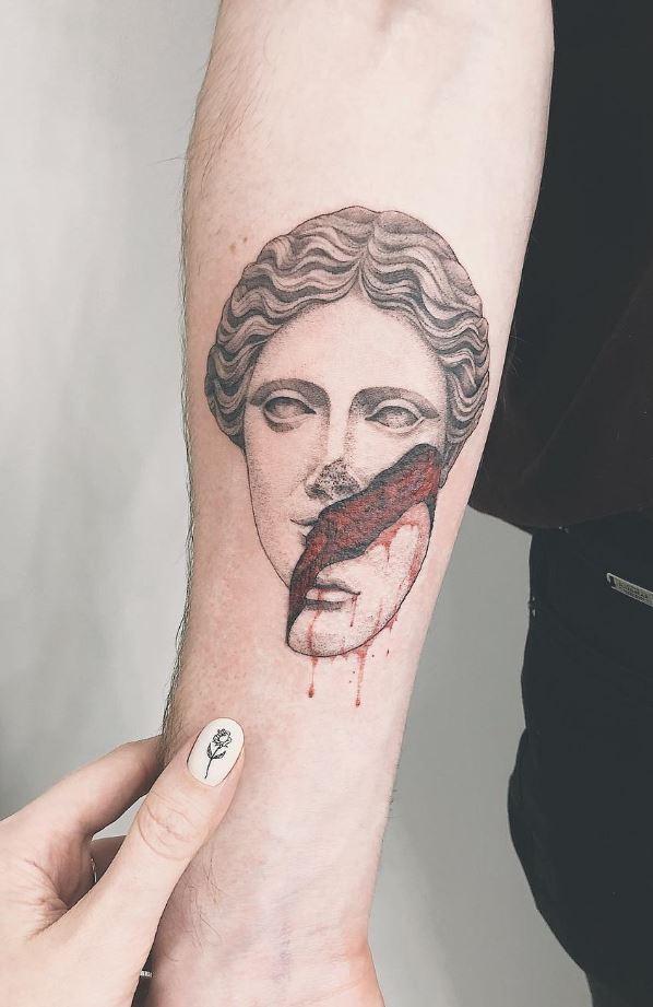 Prodigious Statue Tattoo